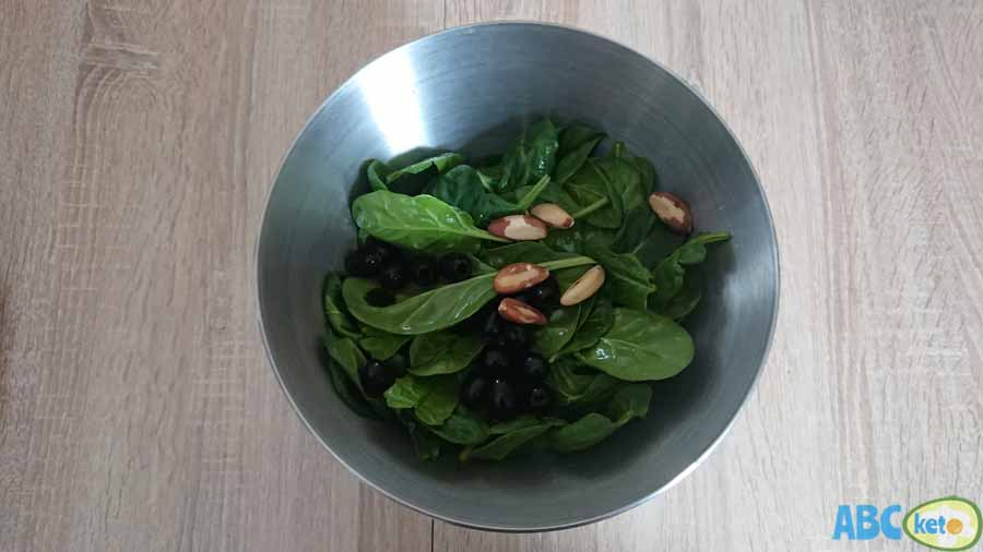Keto smoked salmon salad instructions, adding olives and Brazilian nuts