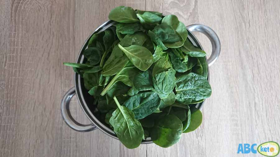 Keto salmon salad ingredients, spinach leaves