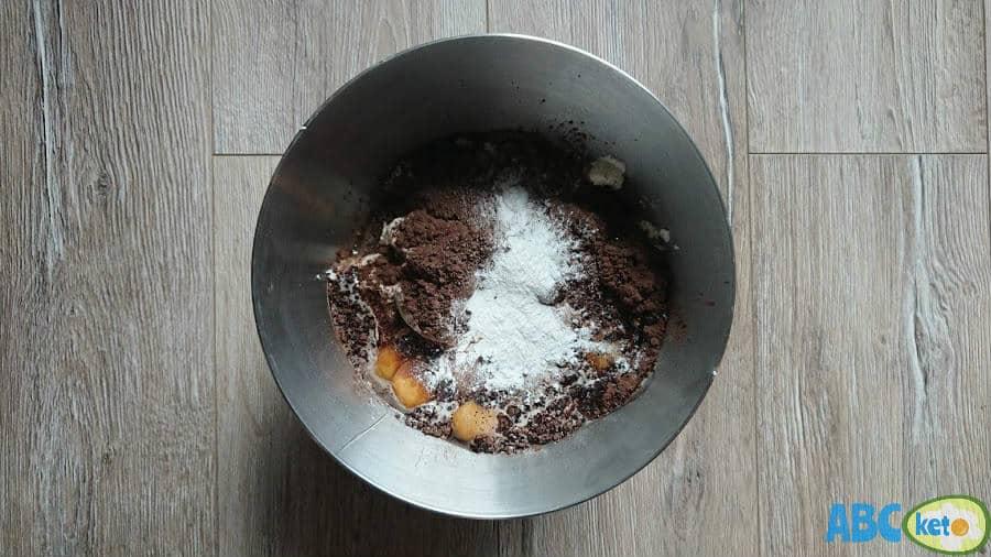 Keto chocolate cheesecake filling, adding eggs and baking powder