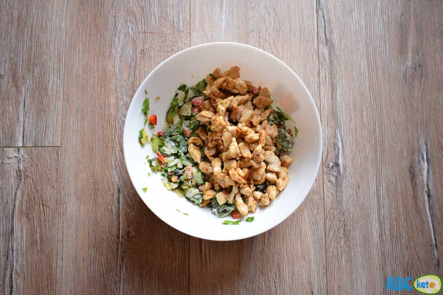 Keto chicken salad recipe, mixing veggies with fried chicken
