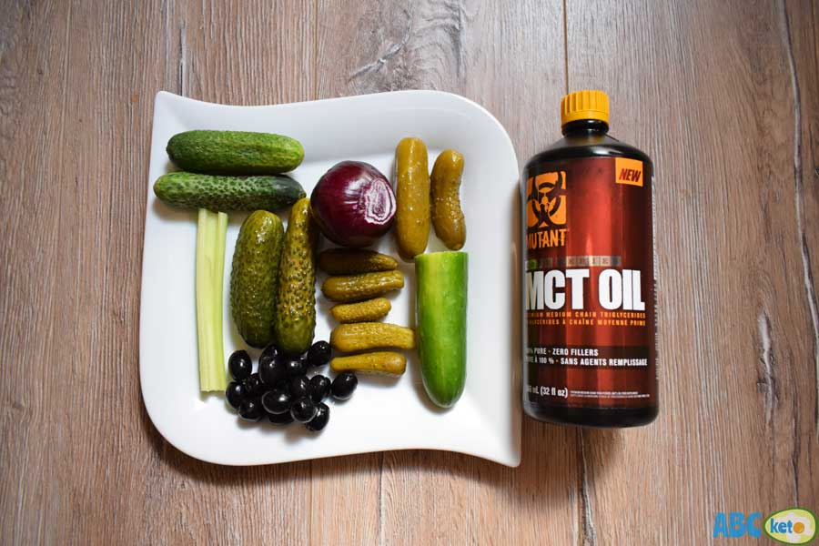 Keto cucumber salad ingredients, cucumbers, olives, celery, MCT oil