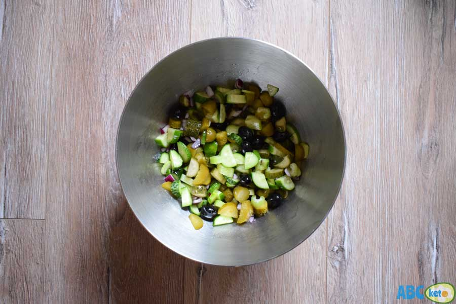 Mixing ingredients for keto cucumber salad