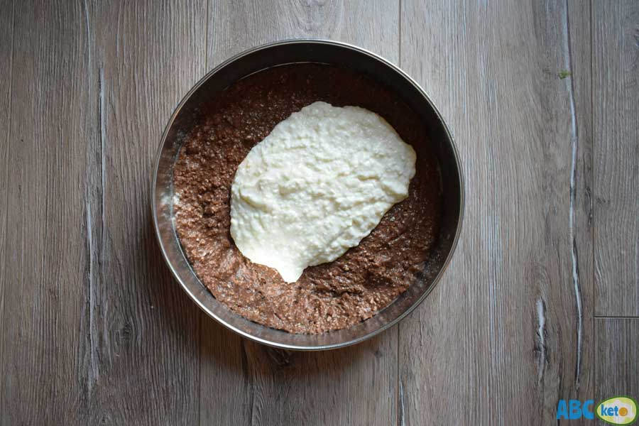 Protein cheesecake, spreading low-fat cheesecake dough on the baking form